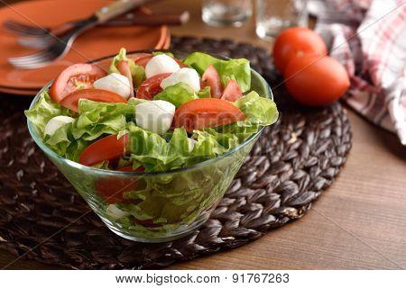 Mozzarella, tomato, and lettuce salad in a bowl
