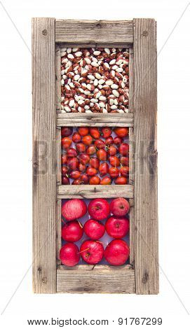 Old Window Frame With Apples, Beans And Rose Hips