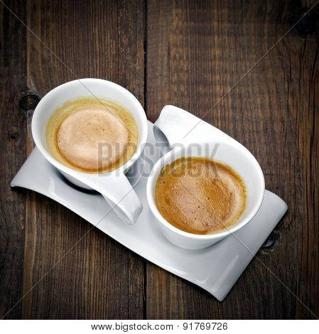 Two White Cups Of Espresso Together On The One Plate