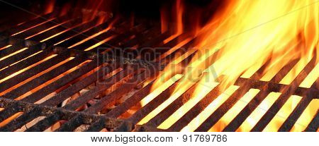Hot Cast Iron Bbq Grill And Blazing Coals Closeup Background