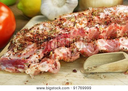 Raw Spare Ribs On Wood Cutting Board With Spices