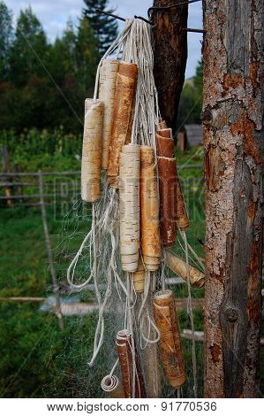 Fishing net with floats made of birch bark.