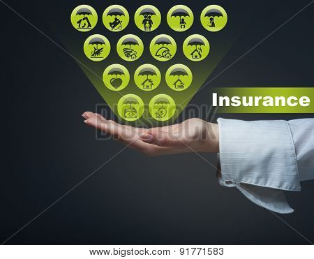 Business Insurance Concept. The Man Is Holding The Symbols Of Insurance