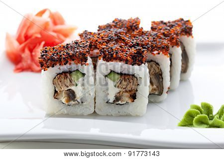 Maki Sushi - Roll made of Cream Cheese, Tamago, Cucumber and Smoked Eel inside. Topped with Red and Black Tobiko