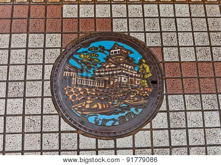 Sewer Manhole With Nakatsu Castle Picture