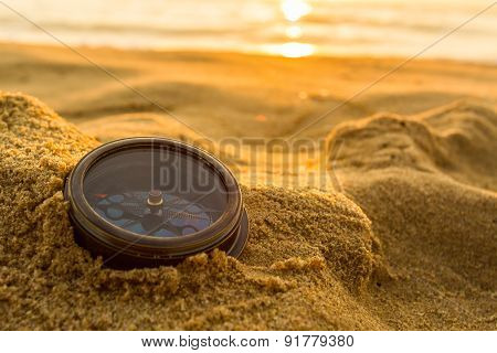 Ancient Compass On The Sand At The Beach Sunrise.