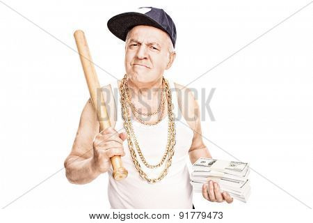 Mature gangster with gold chains holding a baseball bat and stacks of money isolated on white background