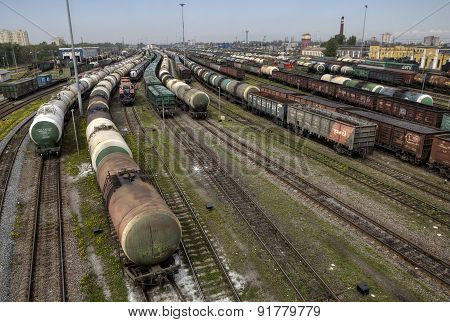 Oil Tank And Trains On Railroad Tracks, Classification Yard, Russia.