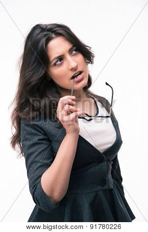 Pensive businesswoman looking up at copyspace isolated on a white background