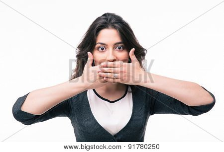 Young businesswoman covering her mouth with hands isolated on a white background