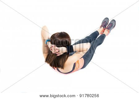Fitness woman doing abdominal exercises isolated on a white background