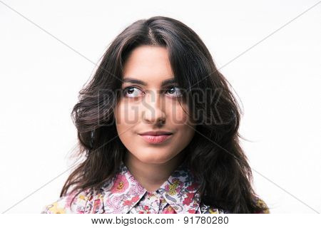 Pensive woman looking up at copyspace isolated on a white background