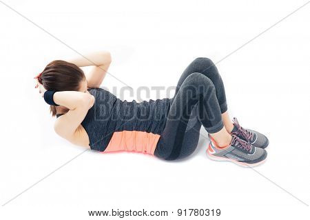 Sporty young woman doing abdominal exercises isolated on a white background