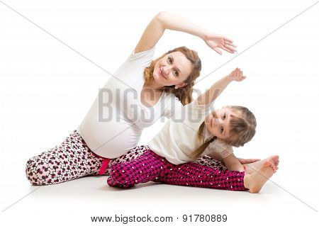Family Doing Gymnastics. Pregnant Woman With Daughter Exercising Stretching On Floor