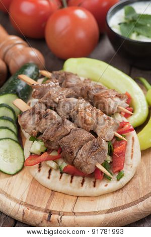 Souvlaki or kebab, meat skewer with pita bread and fresh vegetable