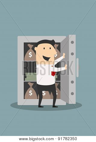 Businessman opens safe with money stacks and bags