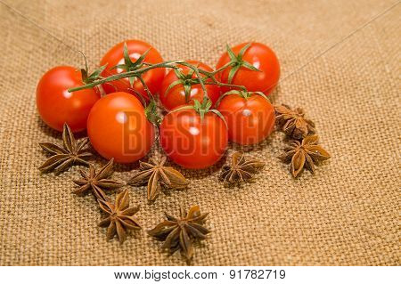 Red Tomatos And Star Anise Fruits On Old Cloth
