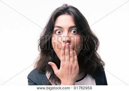 Surprised businesswoman covering her mouth isolated on a white background. Looking at camera