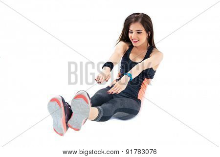Happy sporty woman doing abdominal exercises isolated on a white background