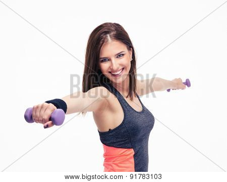 Cheerful fitness woman working out with dumbbells isolated on a white background. Looking at camera