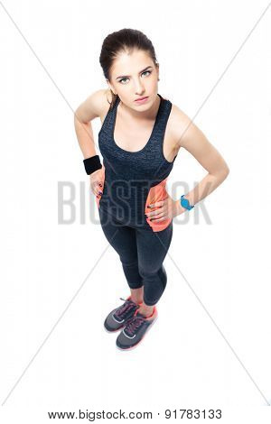 Full length portrait of a serious sporty woman standing isolated on a white background
