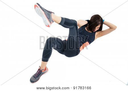 Sporty woman doing abdominal exercises isolated on a white background