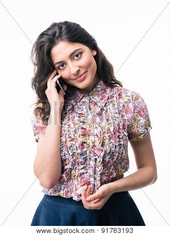 Young woman talking on the phone isolated on a white background. Looking at camera