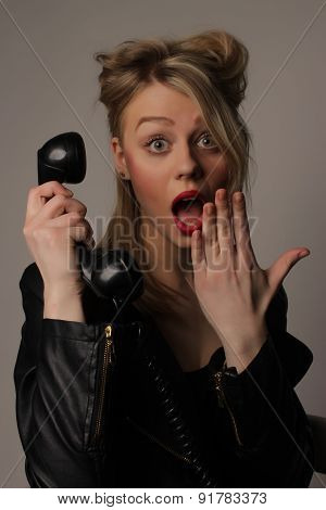 young cute blond girl with an old handset