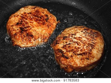 Steaks Are Fried In A Skillet