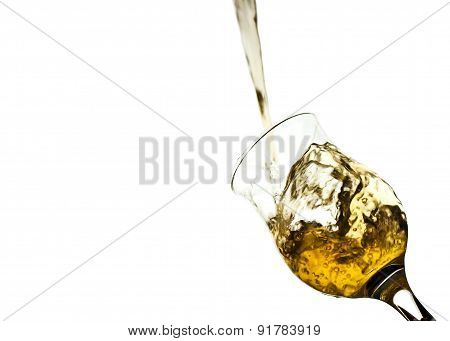 Yellow Water Splashing From Glass Isolated On White Background