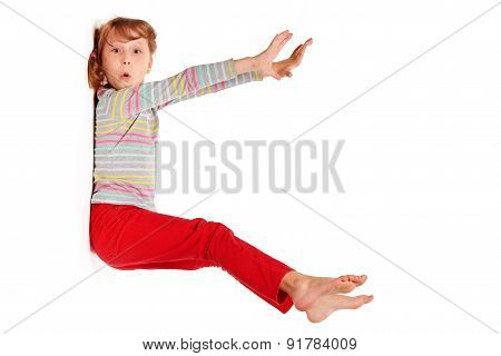 Funny image of amazed girl sticked to white wall