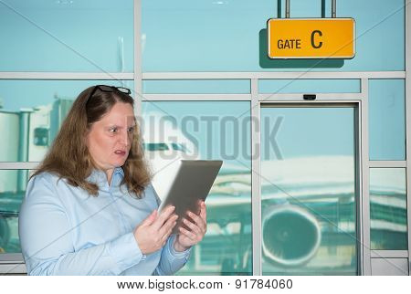 Businesswoman standing stunned at the airport