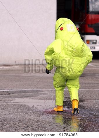 Firefighter With Yellow Protective Gear Against Biological Risk