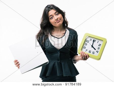 Businesswoman holding folder and clock isolated on a white background. Looking at camera