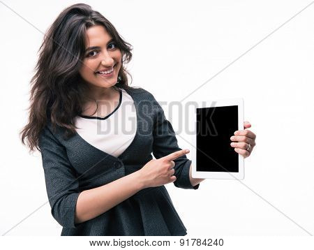 Businesswoman pointing finger on tablet computer screen isolated on a white background. Looking at camera
