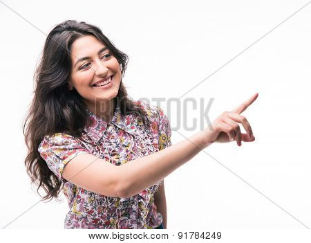 Happy woman pointing finger away isolated on a white background