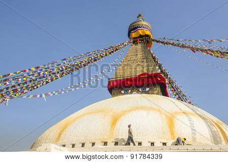 KATHMANDU, NEPAL - CIRCA DEC, 2013: Unidentified pilgrims near stupa Boudhanath. Stupa is one of the largest in the world, of 1979 is a UNESCO World Heritage Site.