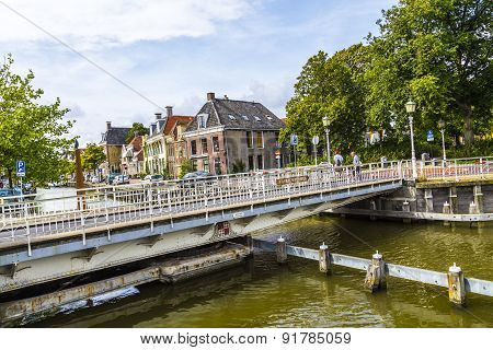People At Bridge In Harlingen, Netherlands