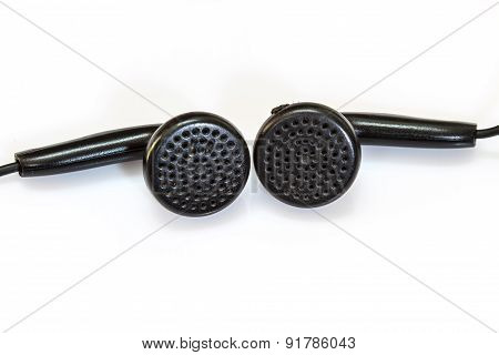 old black earphones on a white