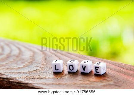 The Inscription Of The Cubes Love On A Wooden Table