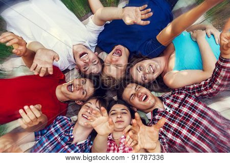 Happy Friends Lying Together In Circle