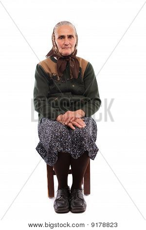 Old Woman Sitting On Chair