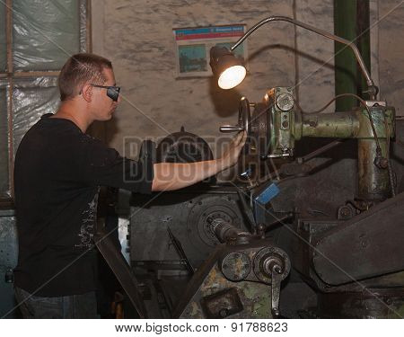 Ukraine, Anthracite - May 15, 2013: Turner In The Workplace. Antratsitovsky Repair And Engineering W
