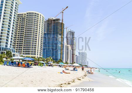 People Enjoy The Beach At Sunny Isles