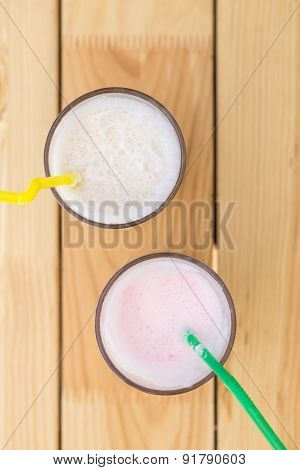 Two Glasses Of Milk Shake On Wooden Table