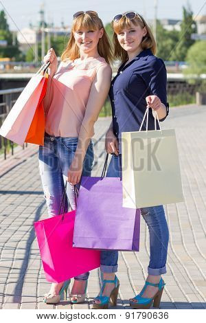 Young Twins Girls Have Fun Holding Their Shopping Bags