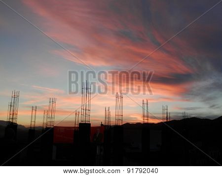 Red Dawn Over Construction Site