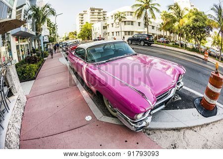 Cadillac Vintage Car Parked At Ocean Drive In Miami Beach