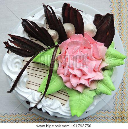 Beautiful cream cake on a white line napkin.