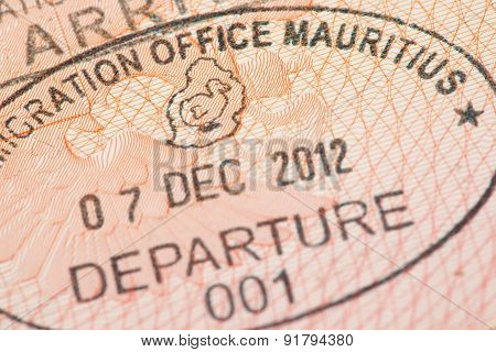 Passport page with Mauritius immigration control departure stamp.